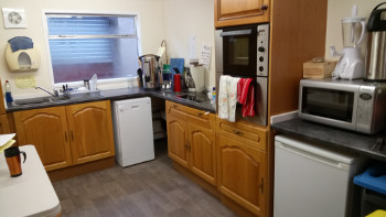 Well-equiped kitchen, toilet facilities and a social area, complete with a wood burning stove